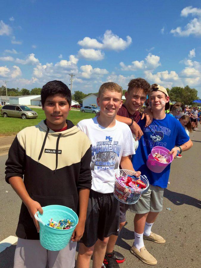 Eric Juarez, Bradon Warren, Drake Amons, and Caden Huntsmen enjoying the parade and candy.